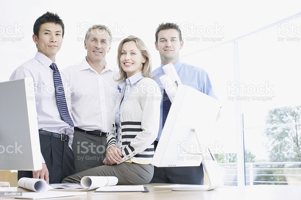 Businesspeople smiling at desk royalty-free stock photo