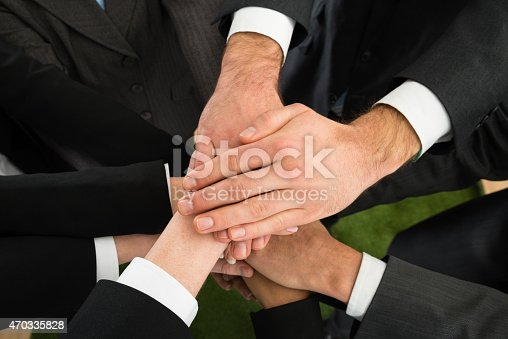 istock Businesspeople Stacking Hands 470335828