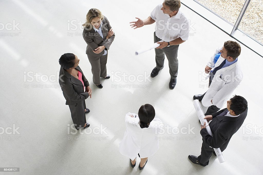 Businesspeople standing having a meeting royalty-free stock photo