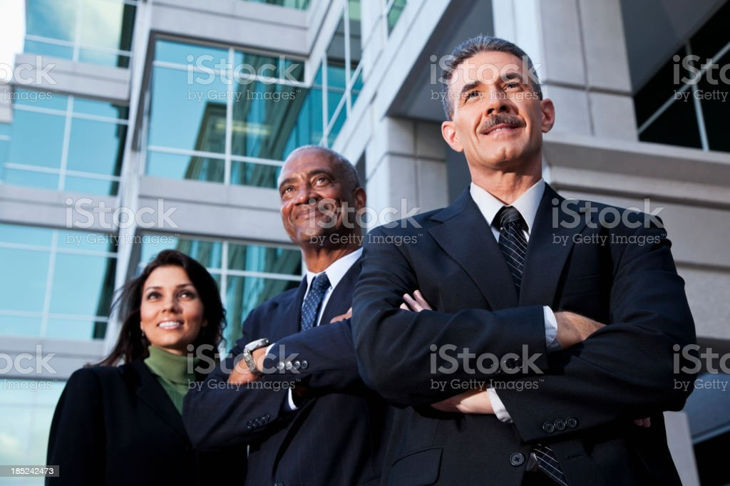 Businesspeople standing outside office building royalty-free stock photo