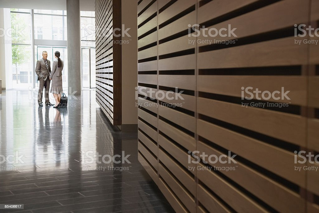 Businesspeople talking in corridor royalty-free stock photo