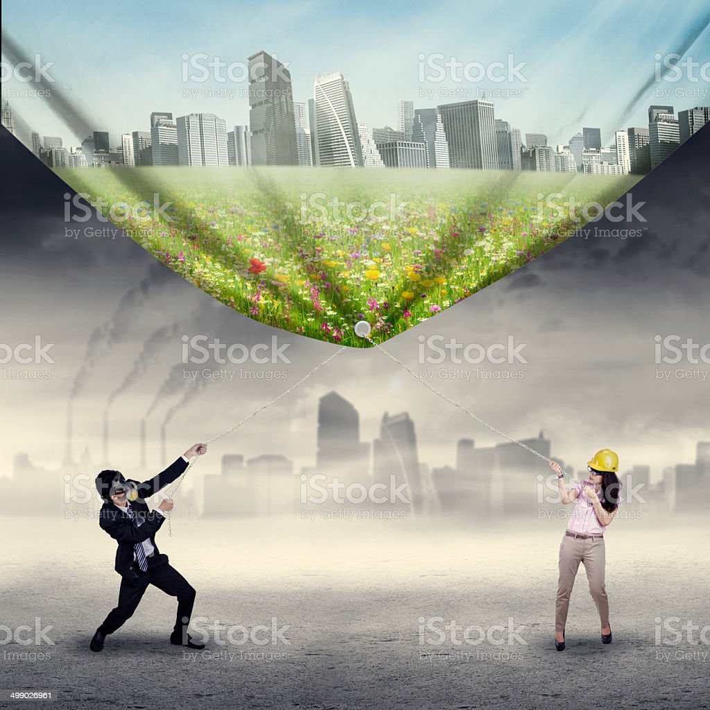 Businesspeople try to save environment stock photo