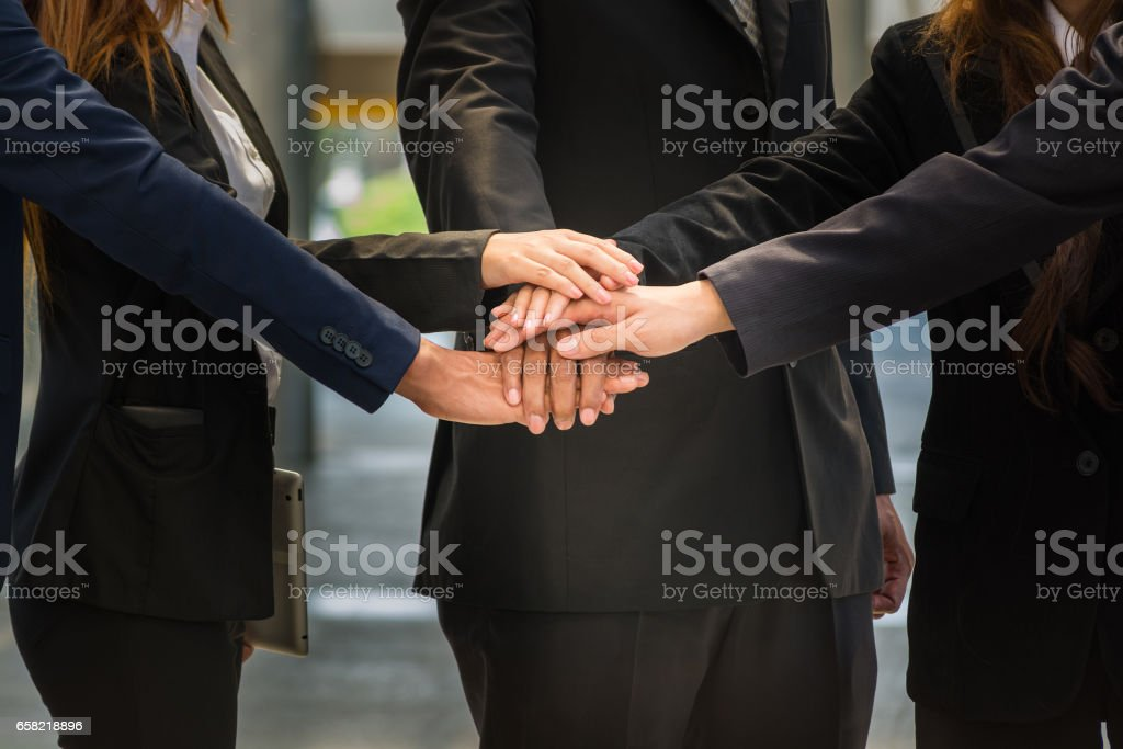 BusinessPeople unite their Hand as Stack to motivate group network stock photo