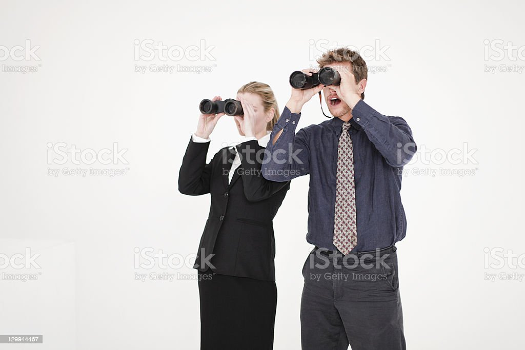 Businesspeople using binoculars stock photo