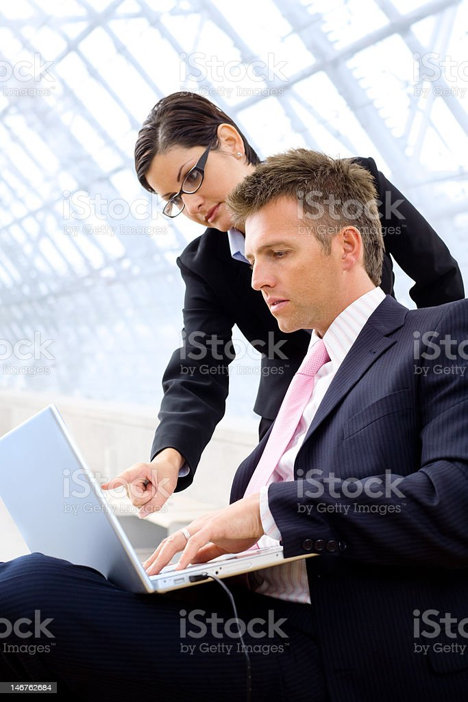 Businesspeople using laptop royalty-free stock photo