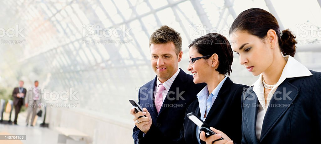 Businesspeople using mobile phone royalty-free stock photo