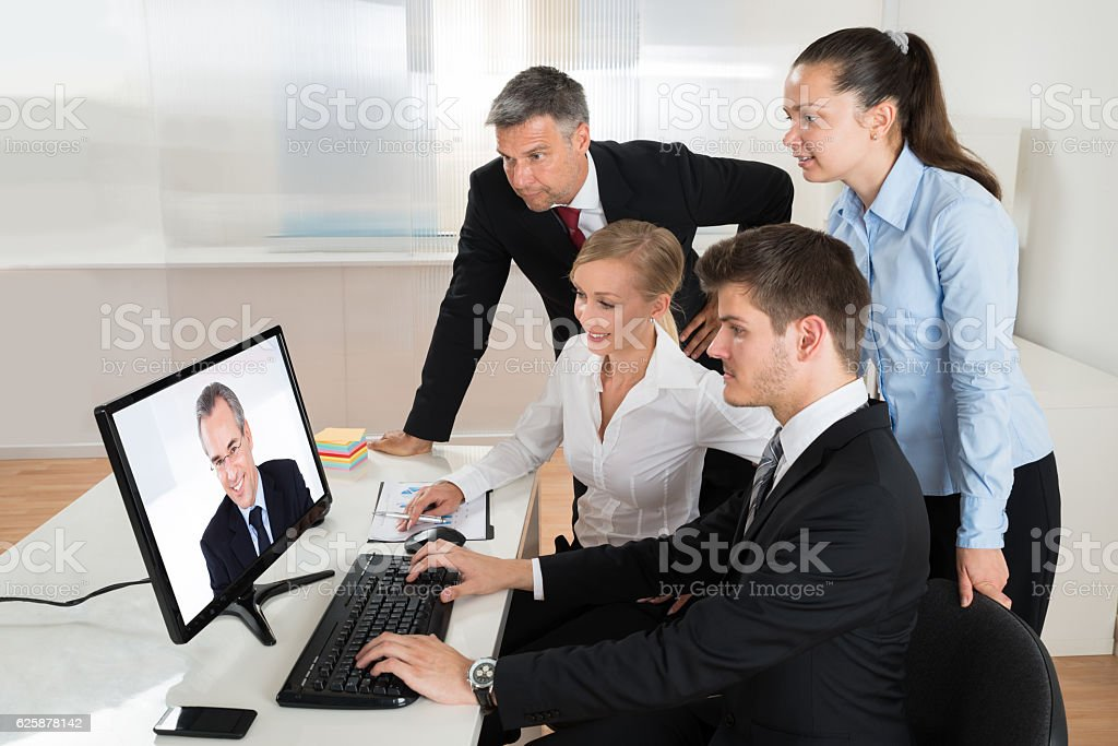 Businesspeople Videoconferencing On Computer stock photo
