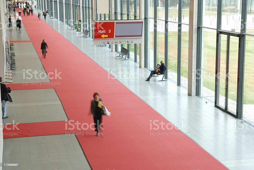 Businesspeople walking in a convention center stock photo