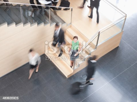 483635979 istock photo Businesspeople walking in busy office building 483635925