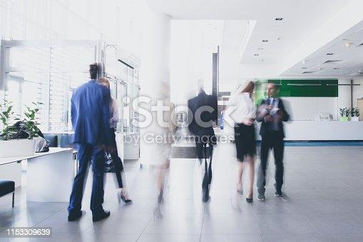 istock Businesspeople walking in corridor 1153309639