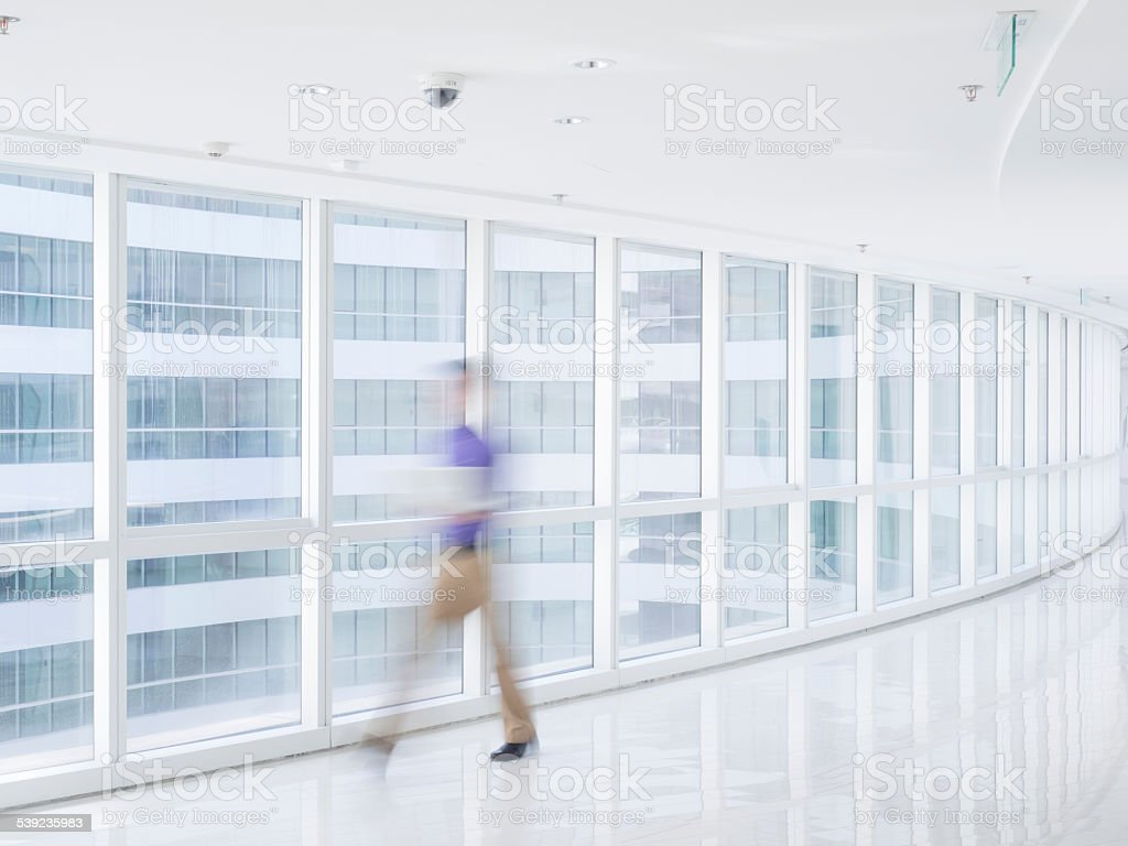 businesspeople walking in the corridor royalty-free stock photo
