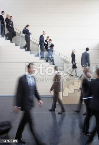 483635979 istock photo Businesspeople walking on busy office staircase 84743238