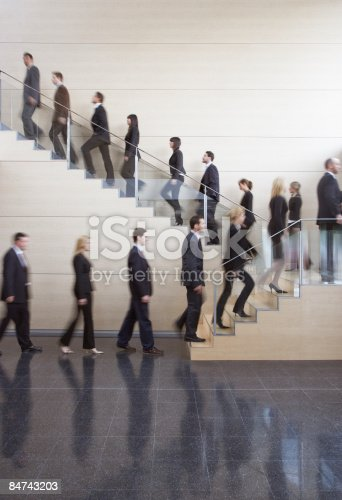 istock Businesspeople walking on office staircase 84743203