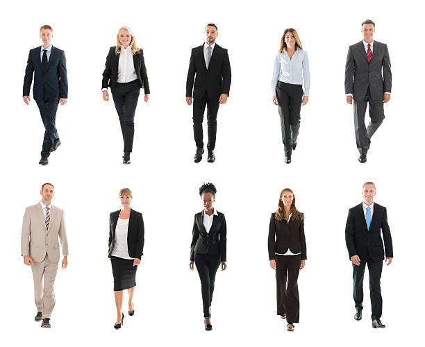 Businesspeople Walking Over White Background stock photo