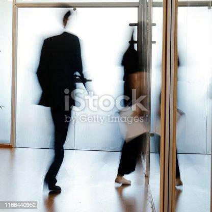 171150458 istock photo Businesspeople walking 1168440952