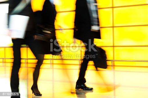 171150458 istock photo Businesspeople walking 511025375