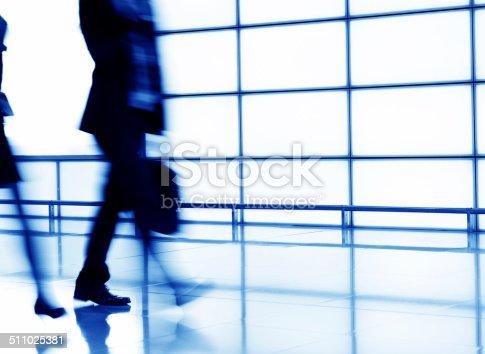 171150458 istock photo Businesspeople walking 511025381