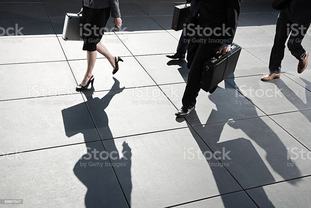 Businesspeople walking stock photo