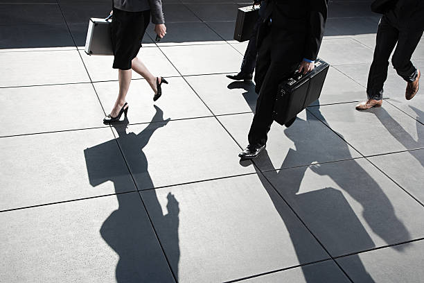 Businesspeople walking stock photo