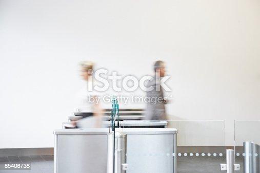 istock Businesspeople walking through turnstile 85406738