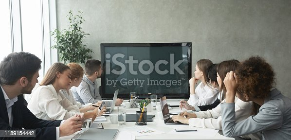 649403294 istock photo Businesspeople watching an online presentation on tv screen 1189154442
