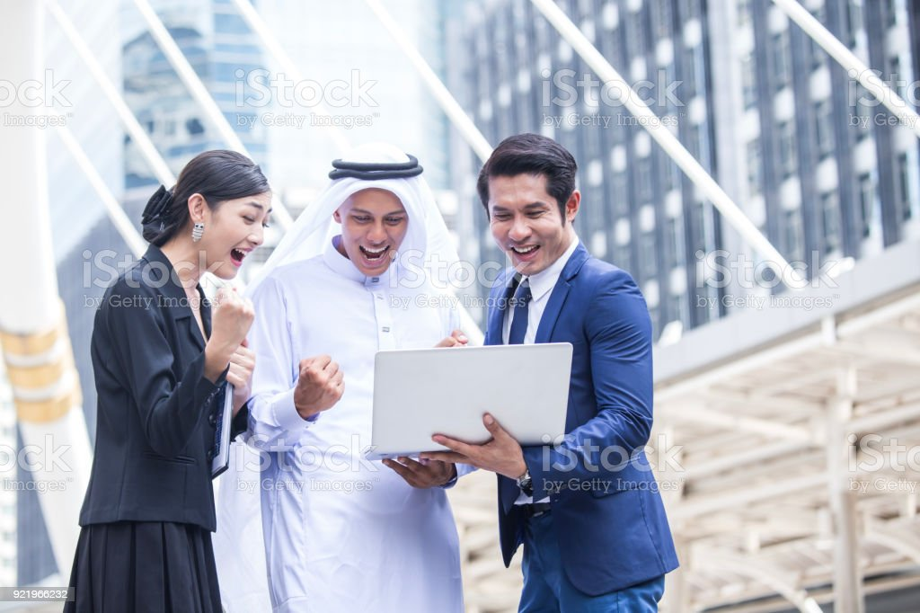 Businesspeople with Arab use Laptop and Success for Work. People and...