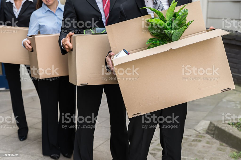 Businesspeople With Cardboard Boxes stock photo
