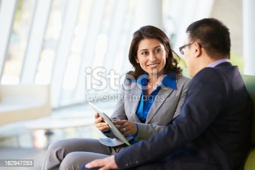 istock Businesspeople With Digital Tablet Sitting In Modern Office 162947253