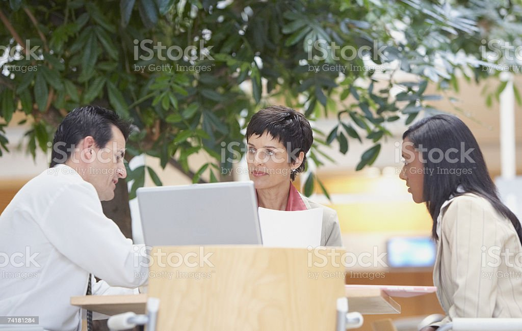 Businesspeople with laptop meeting royalty-free stock photo