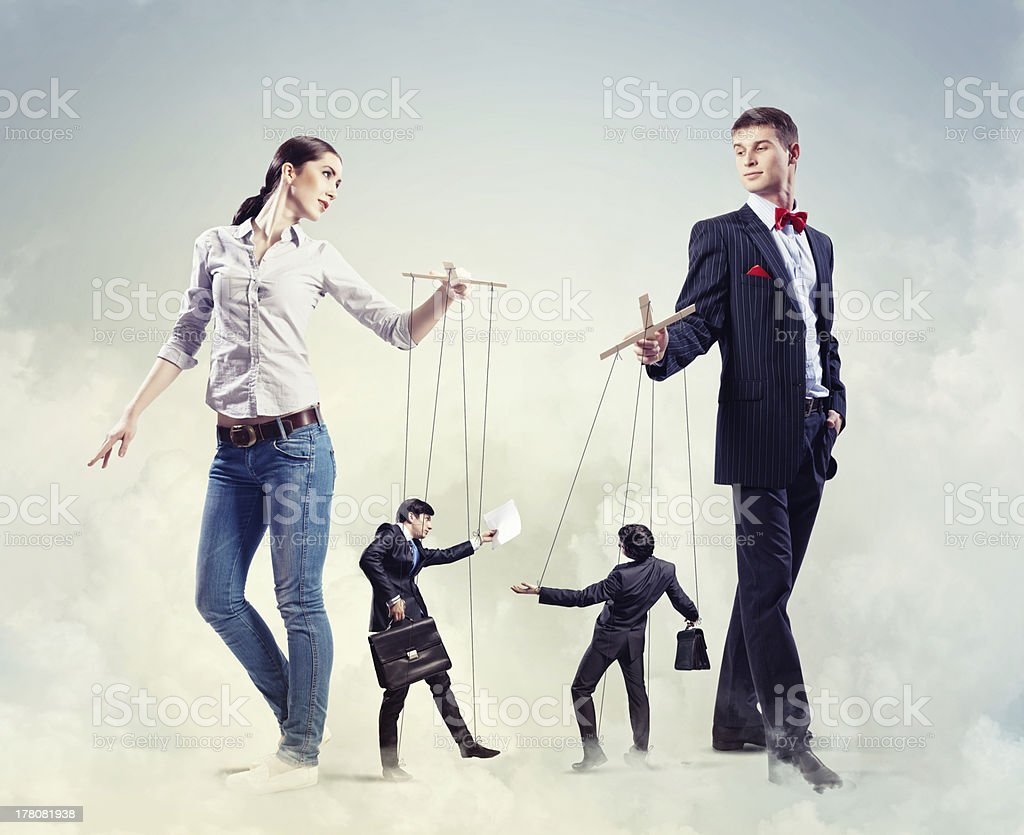 Businesspeople with marionettes royalty-free stock photo