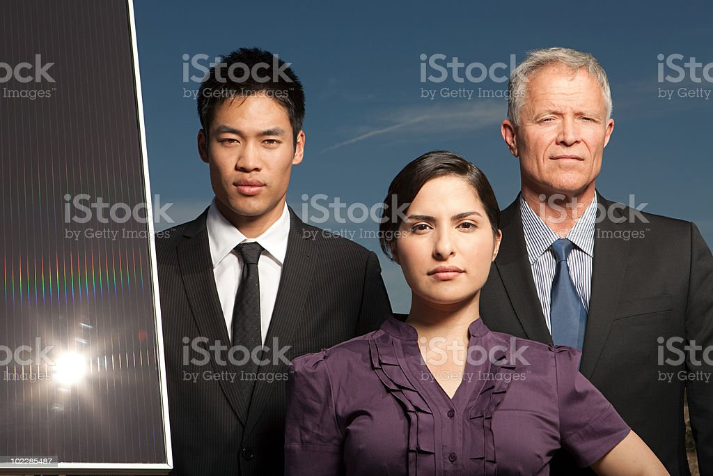 Businesspeople with solar panel royalty-free stock photo