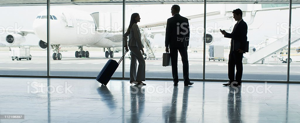 Businesspeople with suitcase in airport stock photo