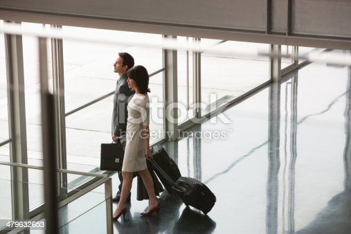 istock Businesspeople with suitcases leaving building 479632653