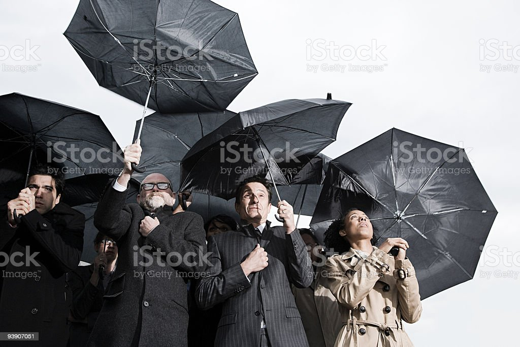 Businesspeople with umbreallas stock photo