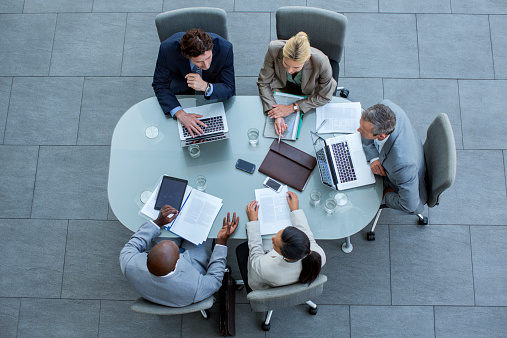 Businesspeople Working At Conference Table Stock Photo - Download Image Now