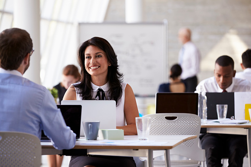 Businesspeople Working At Desks In Modern Office Stock Photo - Download Image Now