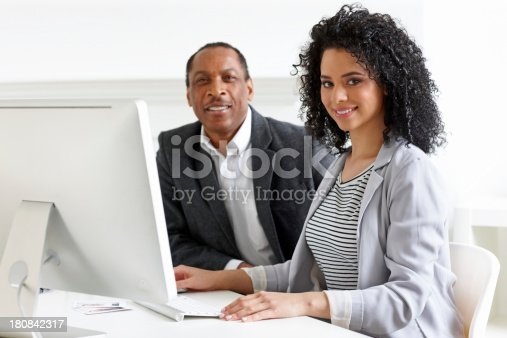 istock Businesspeople working at their desk 180842317