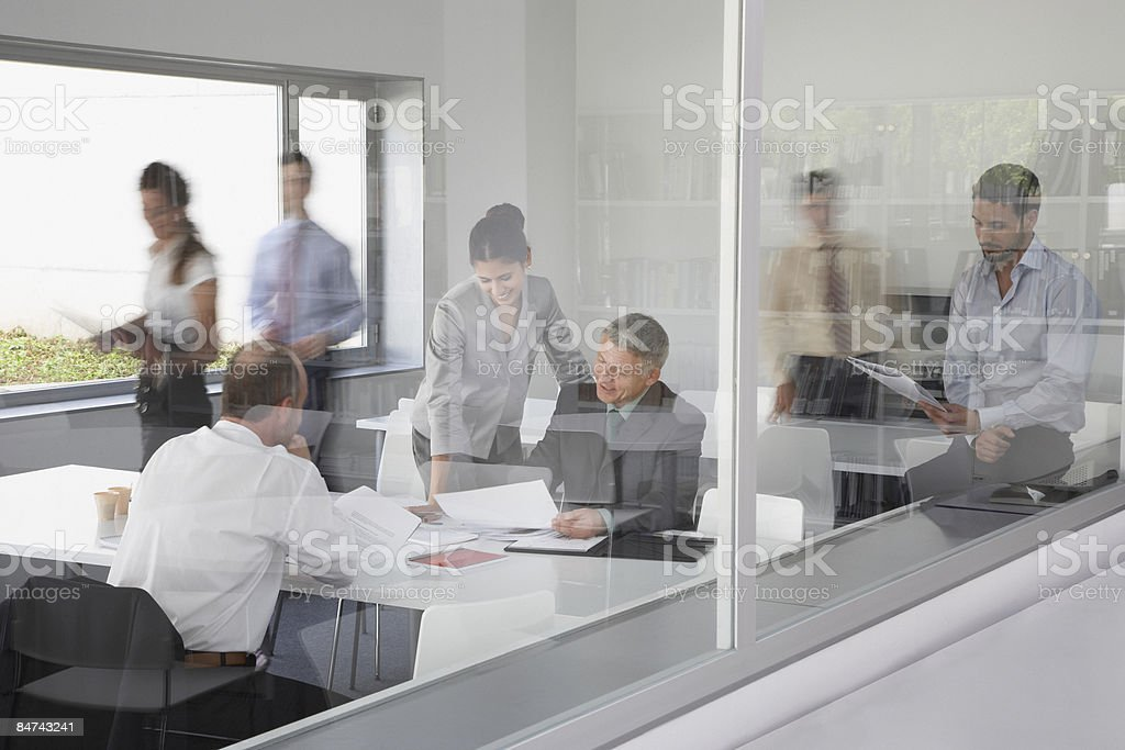 Businesspeople working in busy conference room royalty-free stock photo