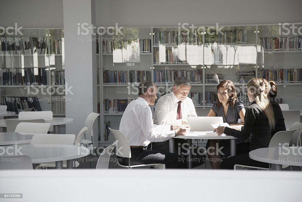 Businesspeople working in conference room royalty-free stock photo