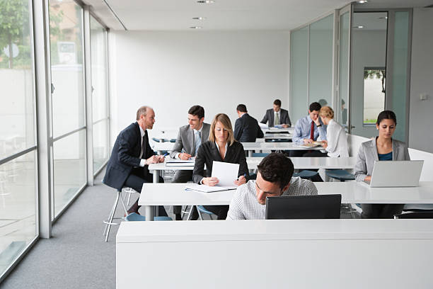 Businesspeople working in corporate training facility picture id483636043?b=1&k=6&m=483636043&s=612x612&w=0&h=elbyqalbue4chnqxejga5tabcgnyr8i2gbm0nfsgugo=