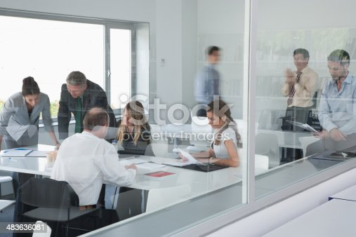 483635979 istock photo Businesspeople working in corporate training facility 483636081