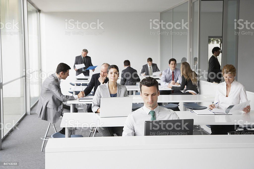 Businesspeople working in corporate training facility royalty-free stock photo