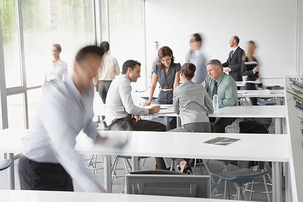 Businesspeople working in corporate training facility picture id84743272?b=1&k=6&m=84743272&s=612x612&w=0&h=5pobskgpplqrzl2ysbs74wv0wxwdbmcvfodbzz3ix20=