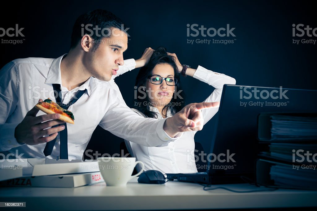 businesspeople working late stock photo