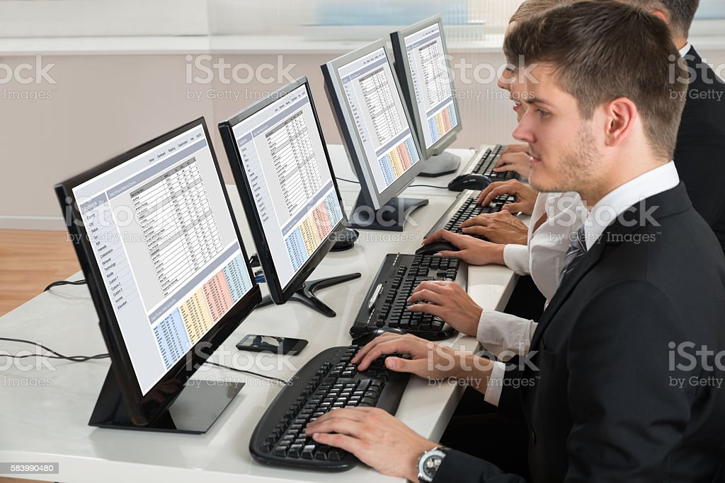 Businesspeople Working On Computer stock photo