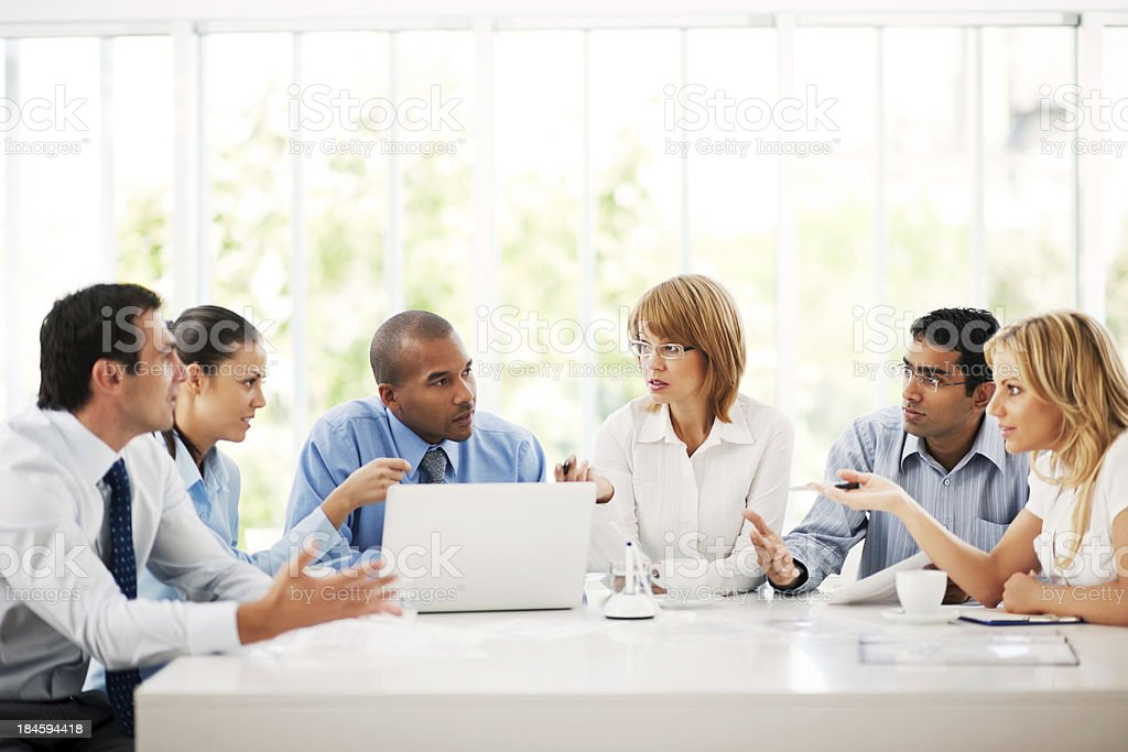 Businesspeople working on laptop in an office royalty-free stock photo