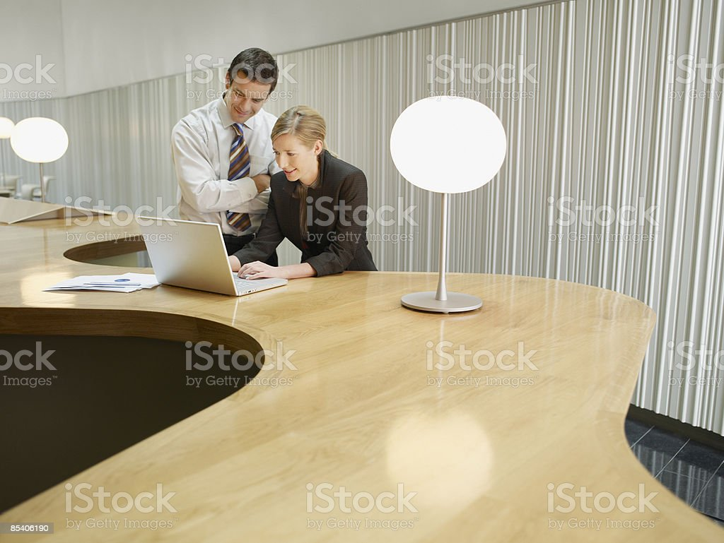 Businesspeople working on laptop in cafe royalty-free stock photo