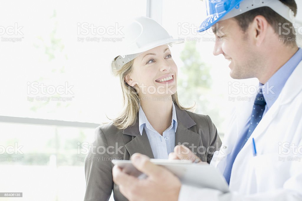 Businesspeople working together in hard-hats royalty-free stock photo