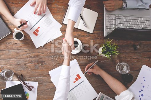 Businesspeople working together in office. Top view.