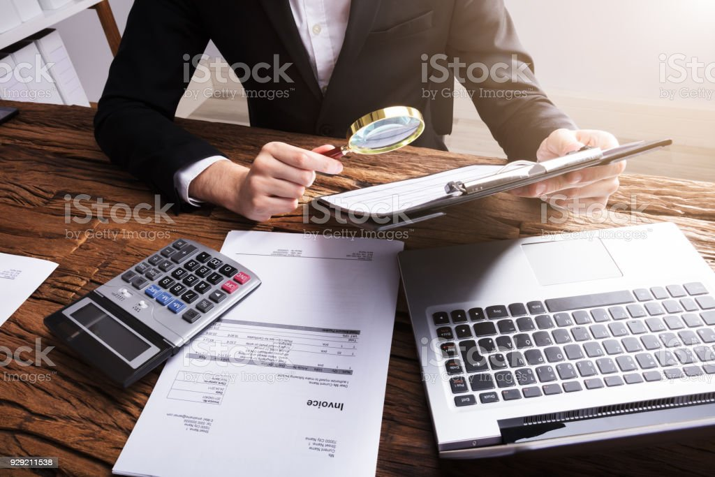 Businessperson Analyzing Bill With Magnifying Glass - foto stock